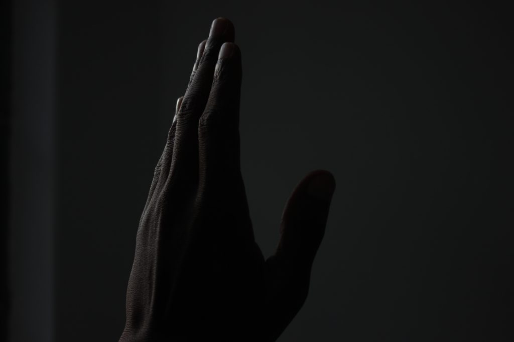 A hand reaching out.