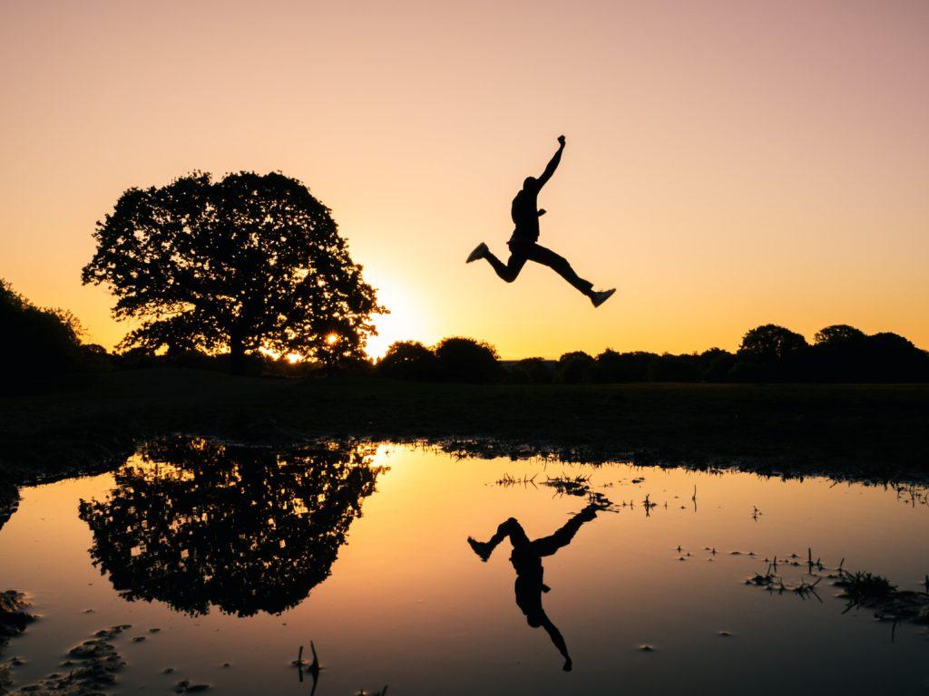 Man taking a big leap.